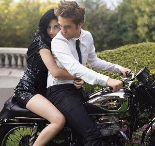 A girl and a guy are on a motorcycle …